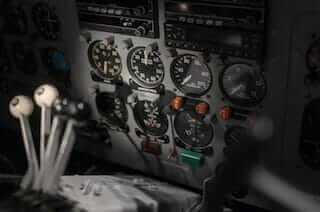 Cockpit of a boat showing a plethora of gauges, meters, receivers and other tools essential for delivery metrics.